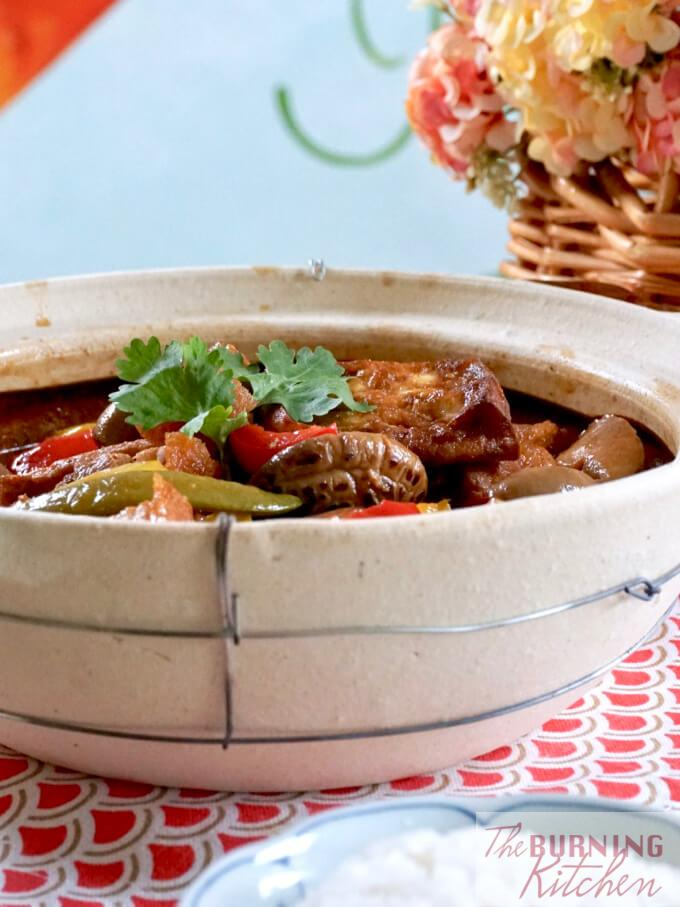 Claypot Tofu with lid uncovered on table top