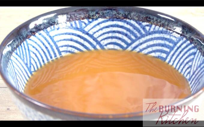 Claypot Tofu sauce in a blue and white China bowl