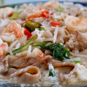 Angled view of Wat Tan Hor Fun served with chilli and spring onions