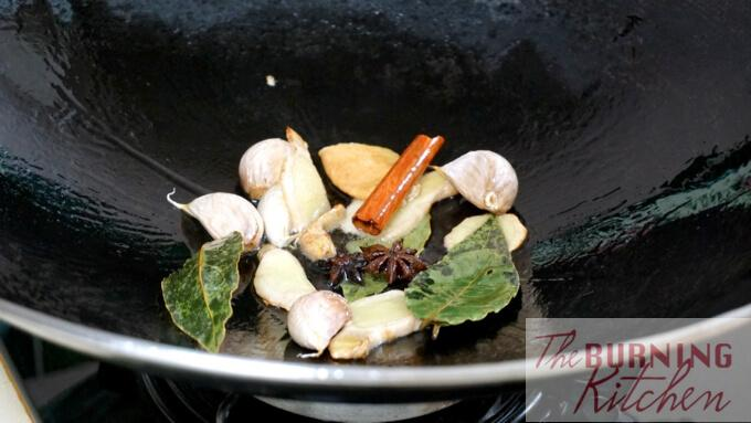 Mix of spices being fried in a wok.