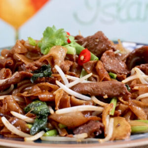 Plate of Dry-Fried beef hor fun with cut chilli