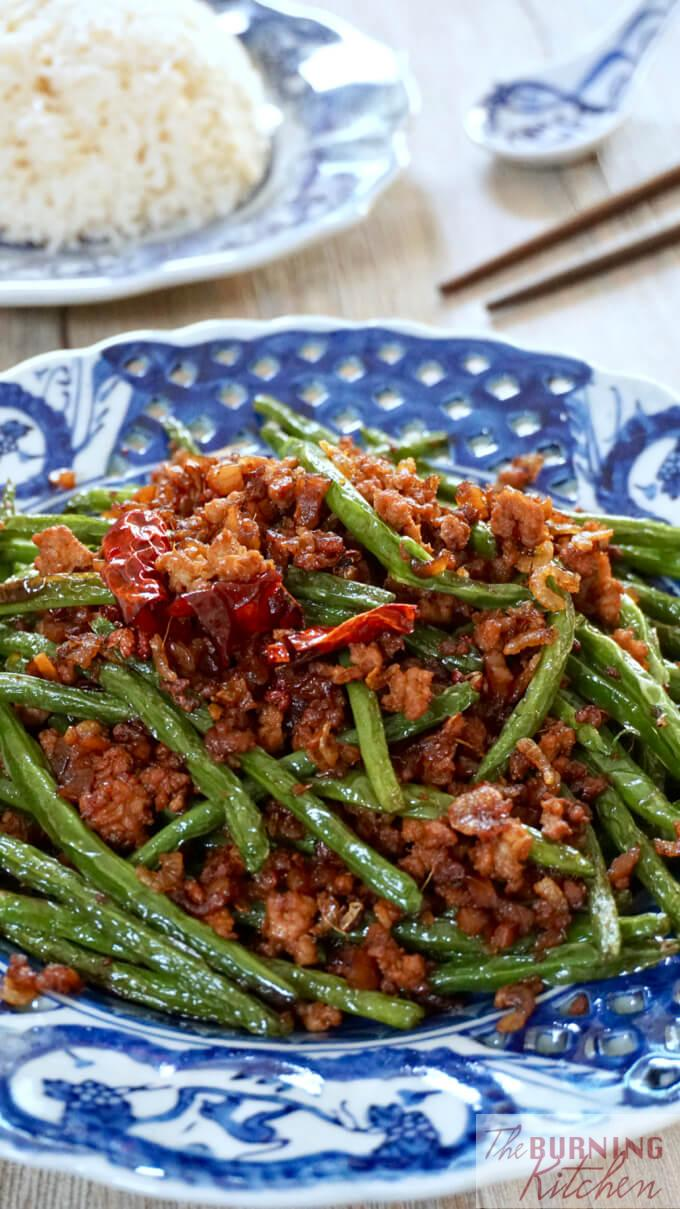 Sichuan dry-fried green beans fried until beautifully blistered on the outside with minced meat and crunchy sweet preserved radish is one of our favourite Chinese restaurant dishes. Learn how to cook this now! #ganbiansizidou #stirfriedgreenbeans #chinesestirfryveg