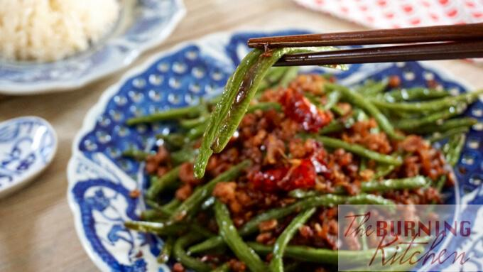 Szechuan Dry-Fried String Beans on porcelain plate landscape