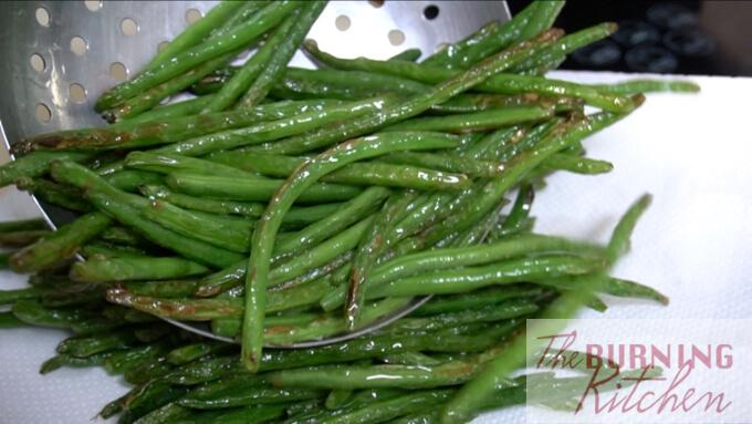 cooked string beans being stored on white paper towel