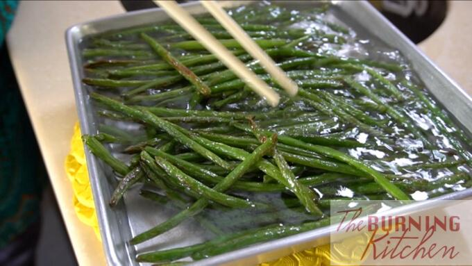 blanching fried string beans in hot water in metal tray