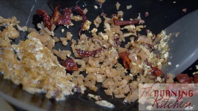 frying ginger, dried shrimp, garlic, dried chilli and chai por in wok
