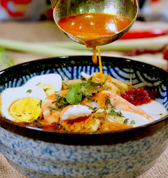 Bowl of Singapore laksa served with sambal chilli