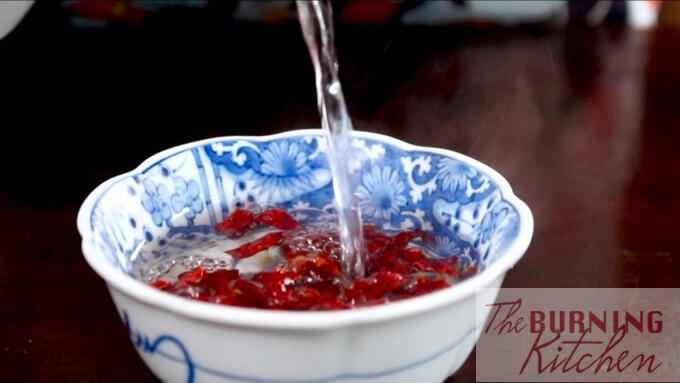 Soaking the dried chilli in hot water