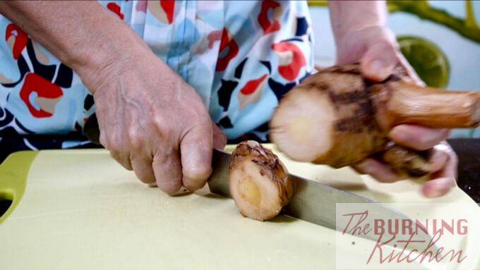 Slicing the blue ginger (galangal)