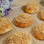 Pork Floss Buns on grill rack with flowers in background