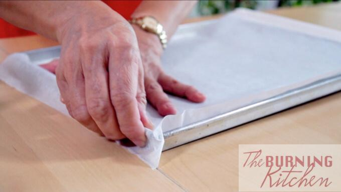 Lining the baking tray with baking paper