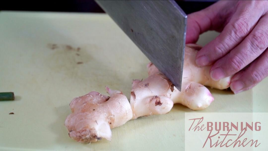 Cutting the young ginger into chunks